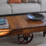 Rustic End Table with Decorative Wheel