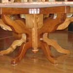 Round Oak Coffee Table with Exciting Base